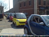 12 smart cars all in a row